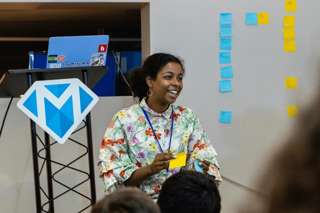 Dina presenting a talk at Flagship 2019